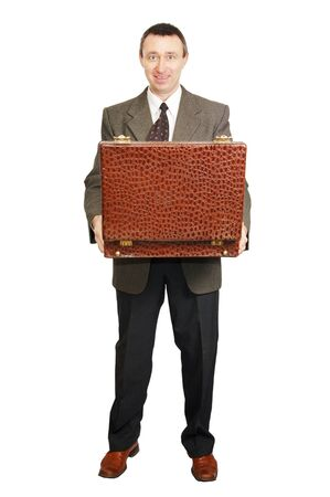 Man holds an open suitcase Stock Photo - 12721749