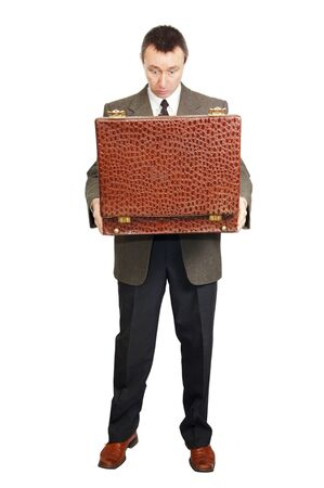 Man holds an open suitcase photo