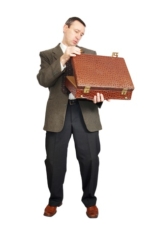 Man looks into the suitcase photo