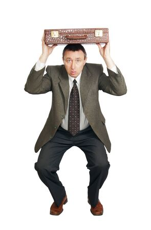 Man covers the head with a suitcase Stock Photo - 12721712