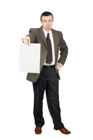 Man holds a blank sheet of paper Stock Photo - 12721686