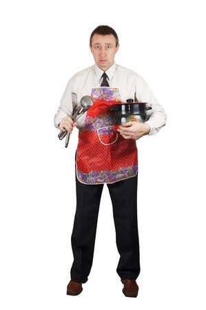 Upset man with kitchen accessories Stock Photo