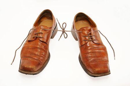Pair of old male shoes with the connected laces Stock Photo - 12894141