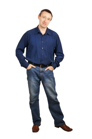 Man in a dark blue shirt and dark blue jeans photo