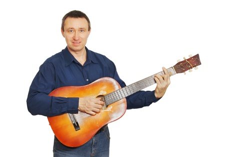 Man plays a guitar photo