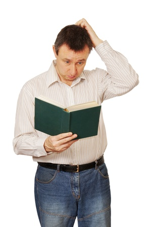 Man reads the book with a great interest photo