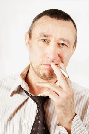 Sleazy man with a cigarette Stock Photo - 12894146