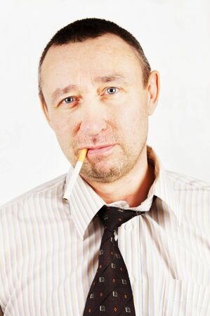 Unpleasant man with a cigarette Stock Photo - 12894143