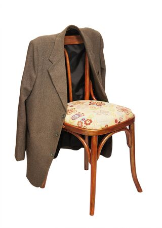 hangs: Green jacket hangs on a chair Stock Photo