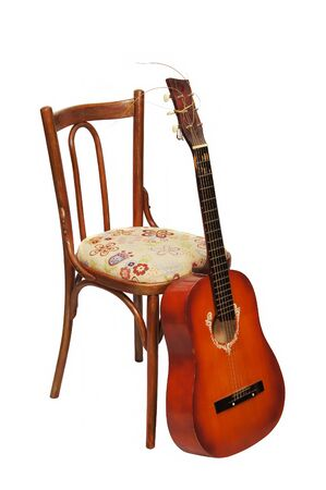 Guitar by a chair Stock Photo - 12894157