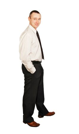 Man in a white shirt and dark pants photo
