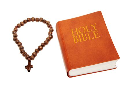 Holy Bible with a a rosary photo