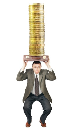 Businessman sat down under the weight of money photo