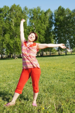 Woman rejoices to good weather photo