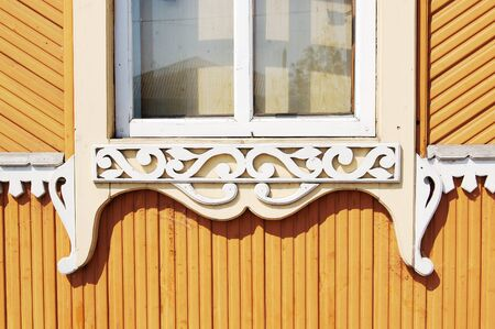 Element of Old Russian architecture of the end of nineteenth century. Wooden carvings. photo