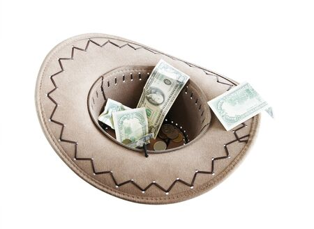 penury: Money in a cowboy hat. Alms Stock Photo