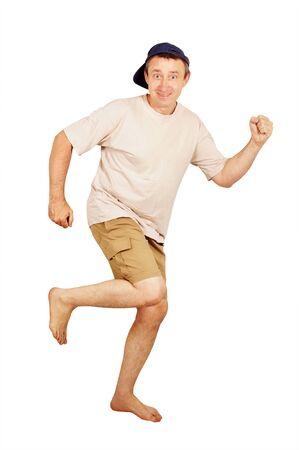 shoeless: Barefoot running man on vacation Stock Photo