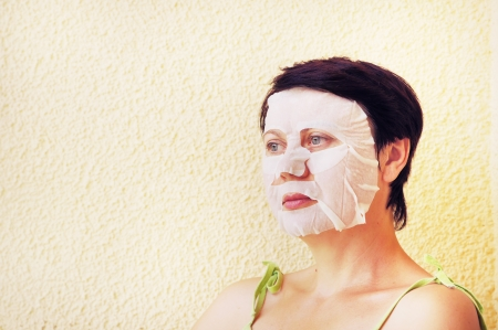 Woman makes facial cosmetic procedures photo