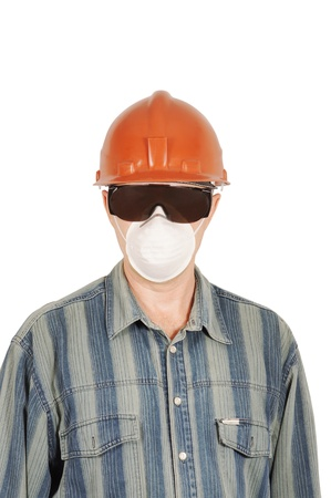 Worker in protective glasses, helmet and respirator photo