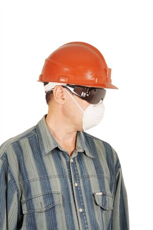 Worker in protective glasses, helmet and respirator Stock Photo - 14402058