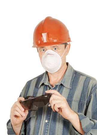 Worker with protective glasses, helmet and respirator photo