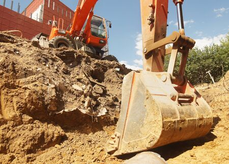 Excavator is digging a pit