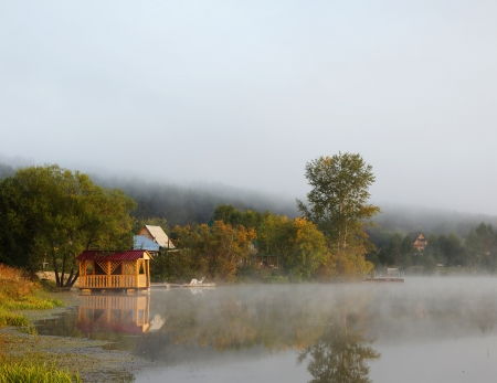 Beautiful misty landscape on the pond with pavilion photo