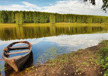 skiff: Beautiful summer landscape on the river with a boat