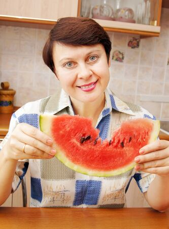 Woman with slice of watermelon photo