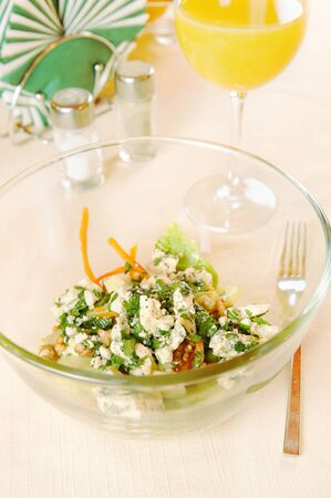 pepperbox: Glass plate with salad on the table