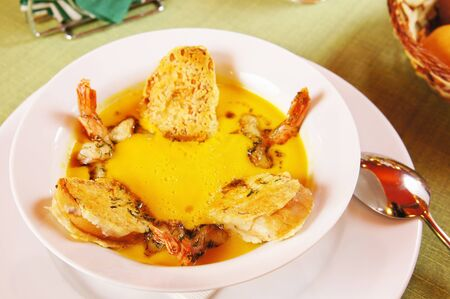 Pumpkin soup with prawns Stock Photo
