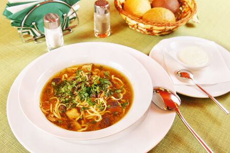 Soup with noodles and mushrooms in a plate Stock Photo - 15716992