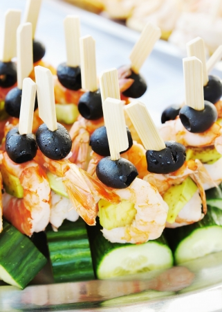 Sandwiches made of fresh cucumber and shrimp photo