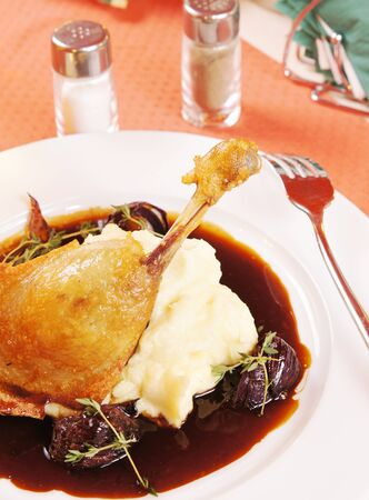Confit of duck with mashed potatoes photo