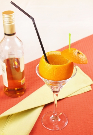 spirituous beverages: Drunk Orange cocktail on a table Stock Photo