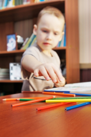 Little boy is learning to draw with pencils Stock Photo - 16119956