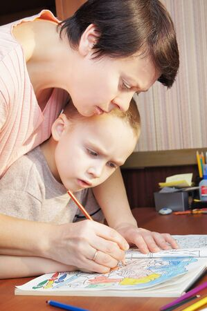 Mother is teaching a son to draw Stock Photo - 16104061