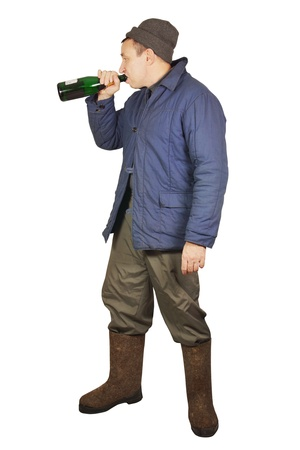 inebriation: Drunkard is drinking from a bottle Stock Photo