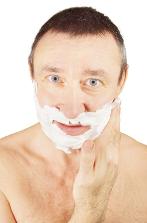 anoint: Man is anointing shaving foam on his cheeks