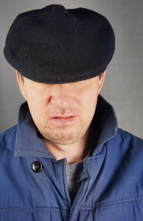 unshaved: Unshaved man in a black cap