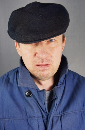 Marginal man in a cap Stock Photo - 17479454