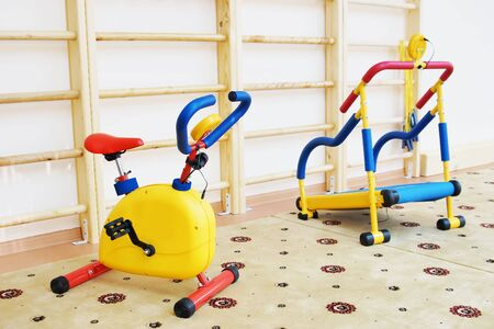 Small athletic simulators in a gymnastic hall for children Stock Photo - 17504769