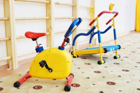 Small athletic simulators in a kindergarten gymnastic hall Stock Photo - 17504767