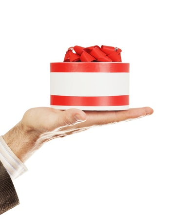 Gift on a male hand isolated over white