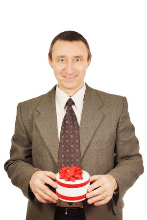 Man holds a small gift with ribbons photo