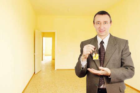 Happy man got a key of new apartment Stock Photo