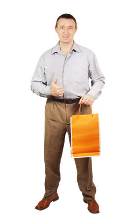 Man with paper package for purchases Stock Photo - 17687195