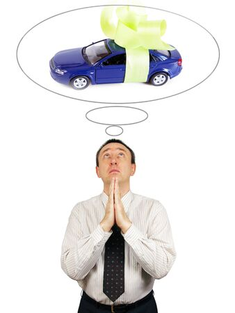 supplicate: Man dreams about new car Stock Photo