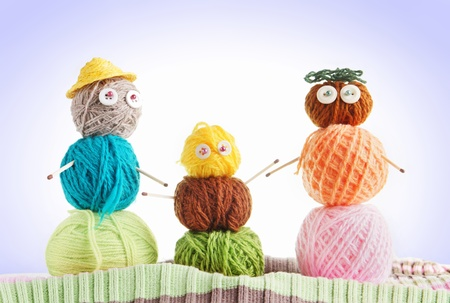 Friendly Family. Conceptual Photo With Toys Made Of Balls Of Yarn 免版税图像