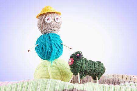 Man With A Dog. Conceptual Photo With Toys Made Of Balls Of Yarn photo